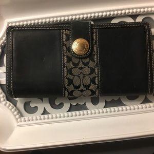 Authentic Coach black wallet.